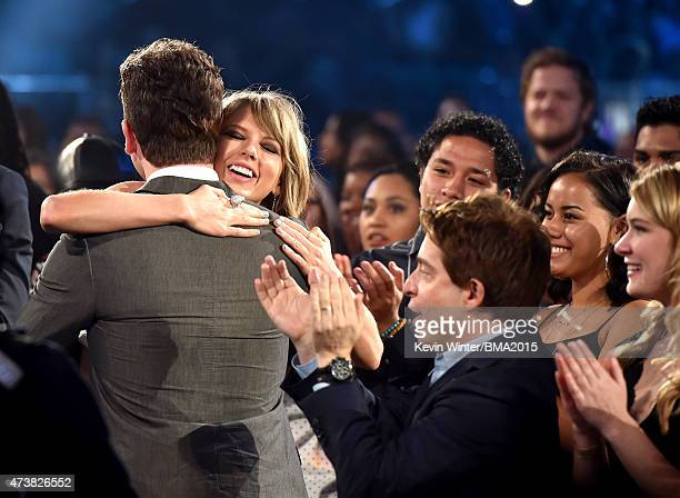 Musician Taylor Swift embraces brother Austin Swift after winning the Top Artist award at the 2015 Billboard Music Awards at MGM Grand Garden Arena...