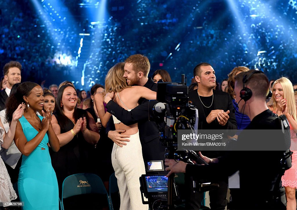 Musician Taylor Swift (C) embraces musician Calvin Harris after winning the Top Artist award during the 2015 Billboard Music Awards at MGM Grand Garden Arena on May 17, 2015 in Las Vegas, Nevada.
