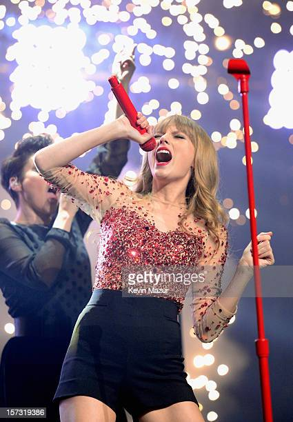 Musician Taylor Swift performs onstage during KIIS FM's 2012 Jingle Ball at Nokia Theatre LA Live on December 1 2012 in Los Angeles California