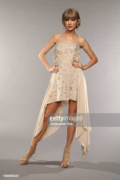 Musician Taylor Swift poses at the Wonderwall portrait studio during the 2013 CMT Music Awards at Bridgestone Arena on June 5, 2013 in Nashville,...