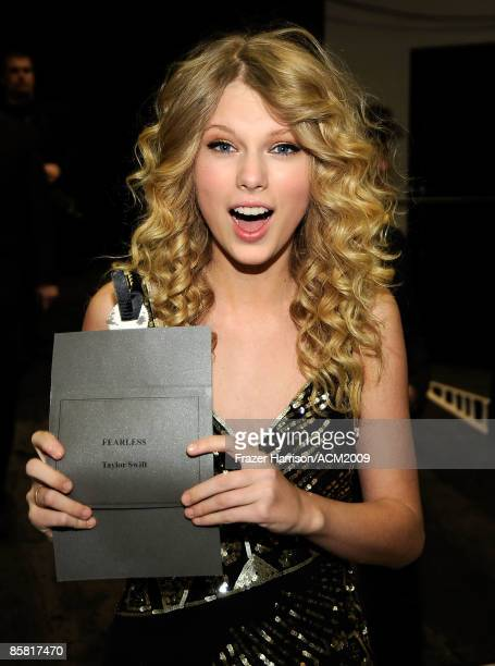 Musician Taylor Swift poses backstage with her Album of the Year award envelop during the 44th annual Academy Of Country Music Awards held at the MGM...