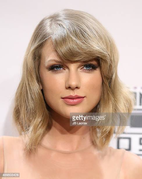 Musician Taylor Swift poses in the press room at the 2014 American Music Awards at Nokia Theatre LA Live on November 23 2014 in Los Angeles California