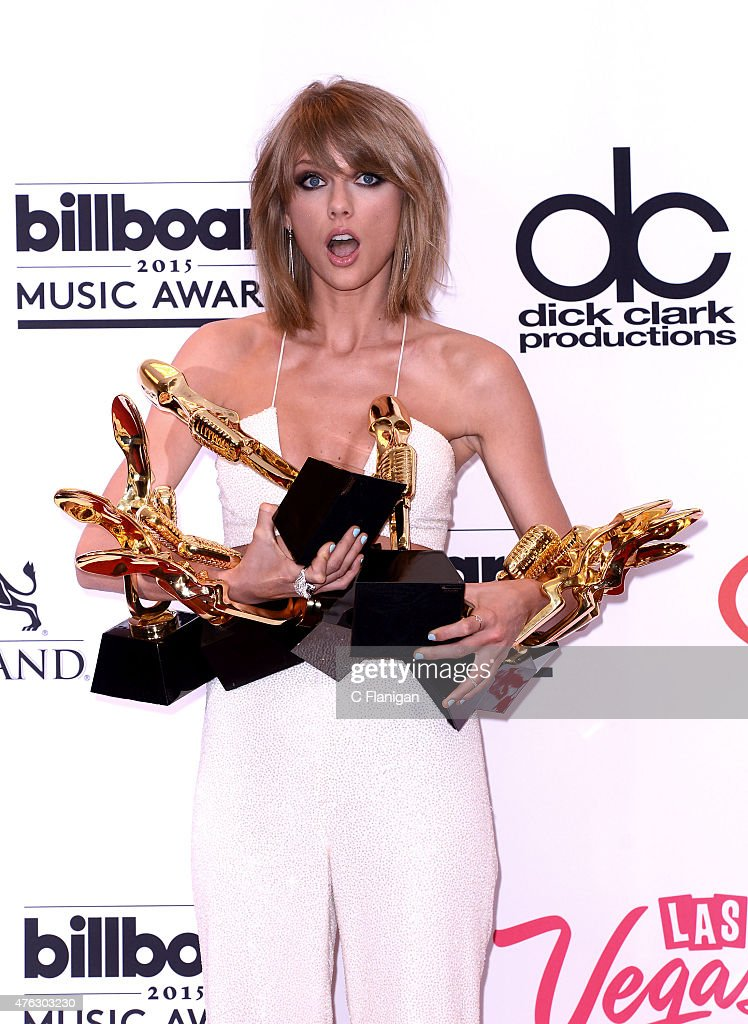Musician Taylor Swift poses in the press room with her eight Billboard Music Awards; Swift won Top Artist, Top Female Artist, Top Billboard 200 Artist, Top Billboard 200 Album for '1989,' Top Hot 100 Artist, Top Digital Songs Artist, Top Streaming Song (Video) for 'Shake It Off,' and Billboard Chart Achievement Award during the 2015 Billboard Music Awards at MGM Grand Garden Arena on May 17, 2015 in Las Vegas, Nevada.