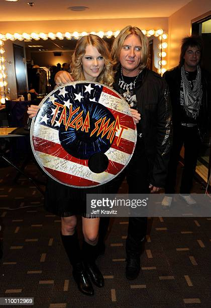 Musician Taylor Swift poses with Joe Elliott of Def Leppard backstage during the 2009 CMT Music Awards at the Sommet Center on June 16, 2009 in...