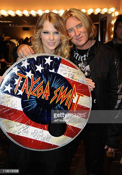 Musician Taylor Swift poses with Joe Elliott of Def Leppard backstage during the 2009 CMT Music Awards at the Sommet Center on June 16 2009 in...