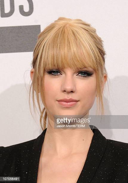 Musician Taylor Swift winner of the Country Music Favorite Female Artist award poses in the press room during the 2010 American Music Awards held at...