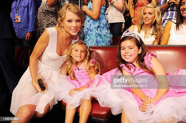 Musician Taylor Swift with Rosie McClelland and Sophia Grace Brownlee in the audience during the 2012 Teen Choice Awards at Gibson Amphitheatre on...
