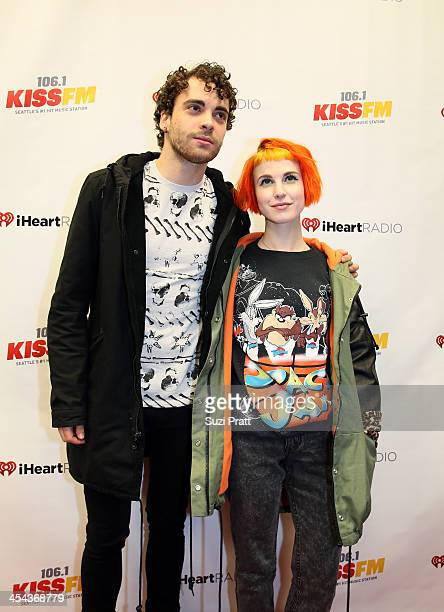 Musician Taylor York and singer Hayley Williams of the band Paramore attend 1061 KISS FM's Jingle Ball 2013 at Comcast Arena at Everett on December 8...