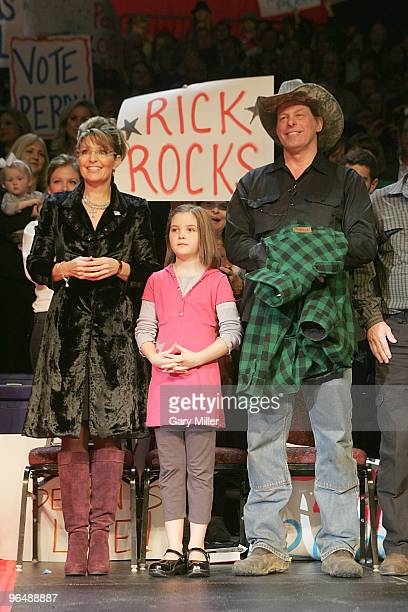 Musician Ted Nugent plays the Star Spangled Banner at a rally for Texas Governor Rick Perry's reelection at the Berry Center on February 7 2010 in...
