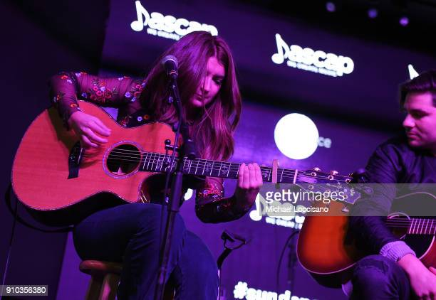 Musician Tenille Townes performs for the CMA Songwriters Series while musician Steven Lee Olsen looks on during the 2018 Sundance Film Festival at...