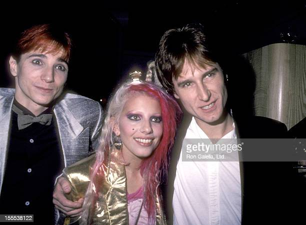 Musician Terry Bozzio musician Dale Bozzio and musician John Waite on August 25 1984 party at Private Eyes in New York City
