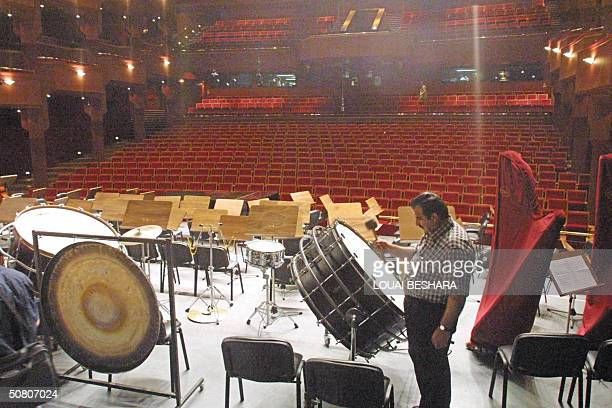 A musician tests the acoustics at the new opera house in Damascus 06 May 2004 The 1500seat opera house the first ever in Syria is part of the 40...