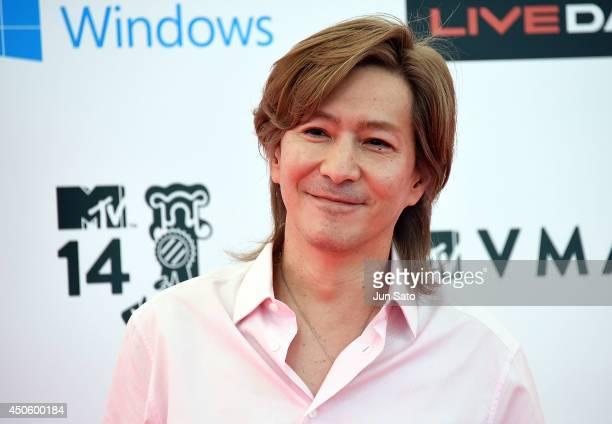 Musician Tetsuya Komuro arrives for the red carpet of MTV Video Music Awards Japan 2014 at Maihama Amphitheater on June 14 2014 in Urayasu Japan