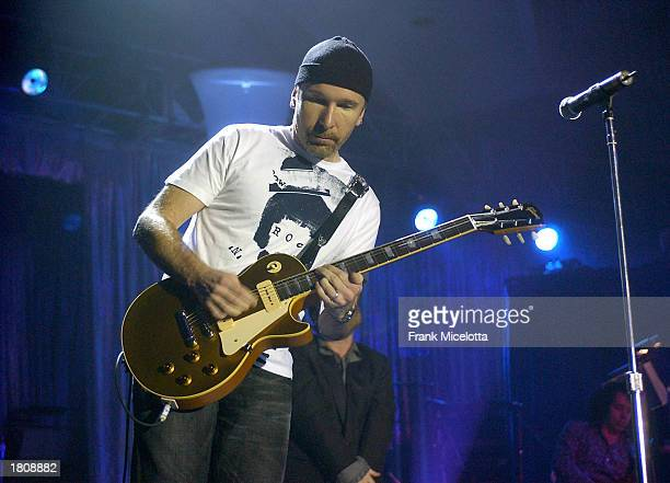 Musician The Edge performs on stage during the13th Annual MusiCares Person Of The Year tribute at the Marriott Marquis February 21 2003 in New York...