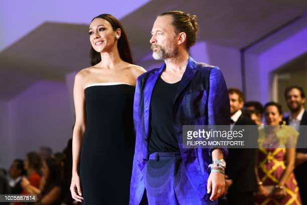 "Musician Thom Yorke and his companion Dajana Roncione arrive for the premiere of the film ""Suspiria"" presented in competition on September 1, 2018..."