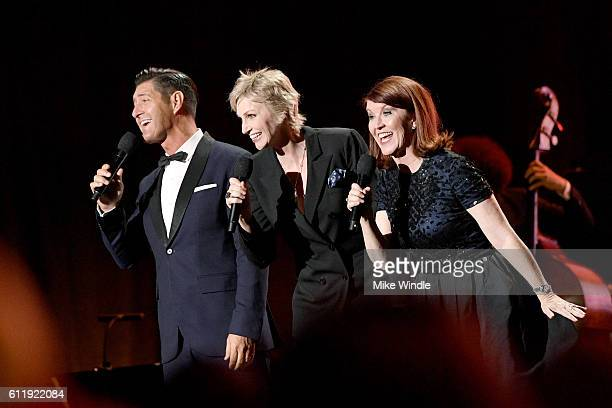 Musician Tim Davis actress Jane Lynch and actress Kate Flannery perform onstage during the MPTF 95th anniversary celebration with 'Hollywood's Night...