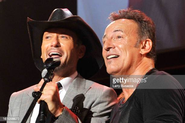 Musician Tim McGraw and Honoree Bruce Springsteen perform onstage at MusiCares Person Of The Year Honoring Bruce Springsteen on February 8 2013 in...