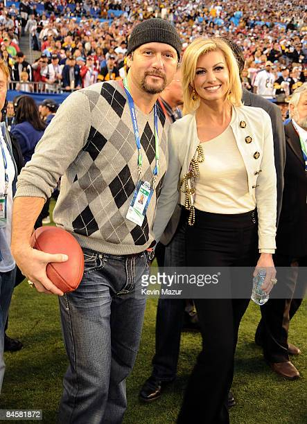 Musician Tim McGraw and singer Faith Hill attend Super Bowl XLIII between the Arizona Cardinals and the Pittsburgh Steelers on February 1, 2009 at...