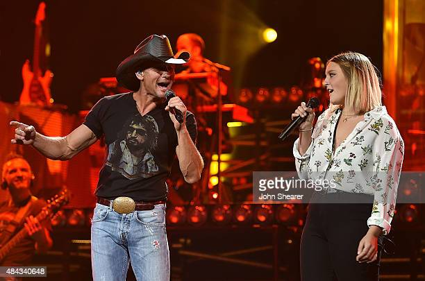 Musician Tim McGraw left performs with his daughter Gracie McGraw on the Shotgun Rider tour at Bridgestone Arena on August 15 2015 in Nashville...