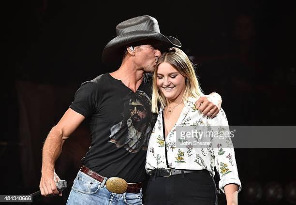 Musician Tim McGraw left performs with his daughter Gracie McGraw on the Shotgun Rider tour at Bridgestone Arena on August 15 2015 in Nashville...