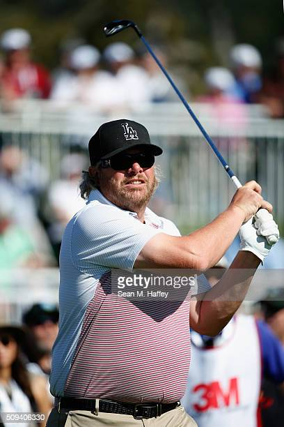 Musician Toby Keith reacts to his drive off the 17th hole during the 3M Celebrity Challenge prior to the ATT Pebble Beach National ProAm at Pebble...