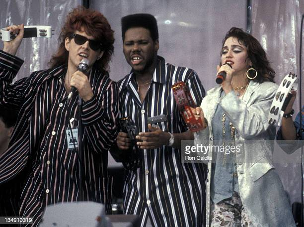 Musician Tom Bailey of the Thompson Twins music producer Nile Rodgers and singer Madonna perform at the Live Aid Concert to Raise Funds for the...