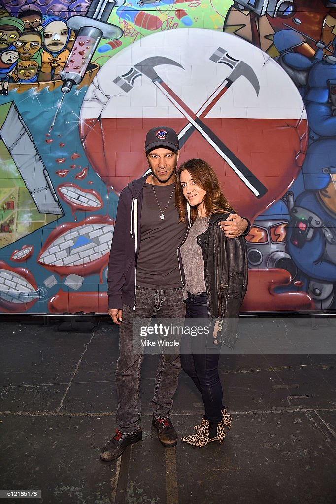 Musician Tom Morello (L) and Denise Luiso attend in celebration of the release of the Limited Edition box set of the film 'Roger Waters The Wall', Roger Waters hosts Los Angeles Event for Brazilian artists Osgemeos' interpretation of 'The Wall' on February 24, 2016 in Los Angeles, California.