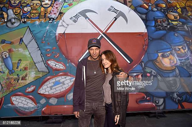 "Musician Tom Morello and Denise Luiso attend in celebration of the release of the Limited Edition box set of the film ""Roger Waters The Wall"", Roger..."