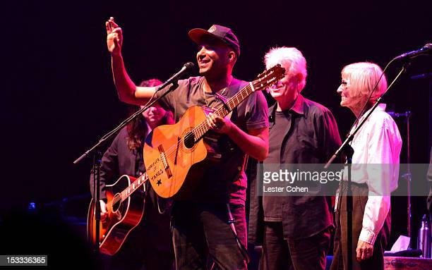 Musician Tom Morello and mother Mary Morello seen onstage in support of the No On Proposition 32 Concert at Nokia Theatre LA Live on October 3 2012...