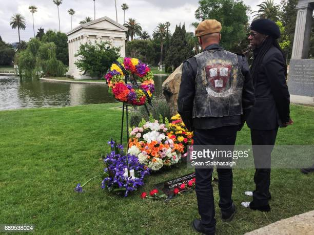 Musician Tom Morello and Producer Nile Rogers view Chris Cornell's tombstone at Hollywood Forever on May 26 2017 in Hollywood California The...