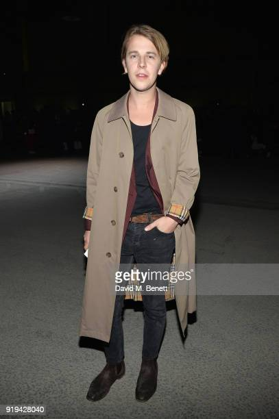 Musician Tom Odell wearing Burberry at the Burberry February 2018 show during London Fashion Week at Dimco Buildings on February 17 2018 in London...