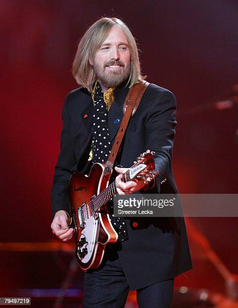 Musician Tom Petty performs at the Bridgestone halftime show during Super Bowl XLII between the New York Giants and the New England Patriots on...