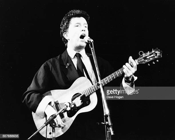 Musician Tom Robinson performing on stage at a charity concert to raise AIDS awareness Wembley Arena London April 3rd 1987