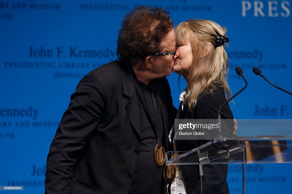 Musician Tom Waits Kisses His Wife And Song Writing Parter Kathleen Brennan After Receiving The PEN