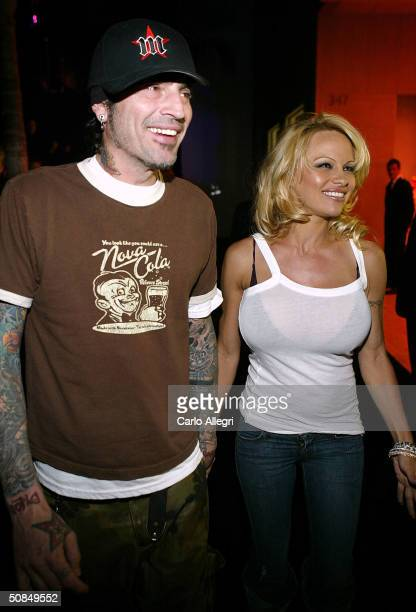 Musician Tommy Lee and actress Pamela Anderson leave the party at the 'Rodeo Walk of Style' Award on Rodeo Drive March 28 2004 in Beverly Hills...