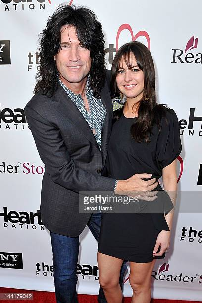 Musician Tommy Thayer and Amber Thayer arrive at the Heart Foundation Gala Arrivals at the Hollywood Palladium on May 10 2012 in Los Angeles...