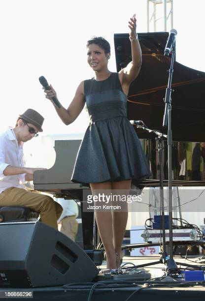 Musician Toni Braxton performs at the 30th Annual Breeders' Cup 'Songs In The Saddle The Infield Music Fest' at Santa Anita Park on November 2 2013...