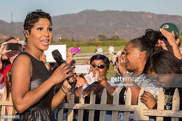 Musician Toni Braxton performs onstage at the 30th Annual Breeder's Cup Songs in the Saddle concert at Santa Anita Park Racetrack on November 2 2013...