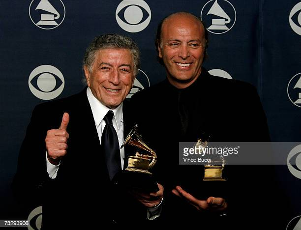 Musician Tony Bennett and his son Danny Benett poses with his Grammys for Best Tradionial Pop Vocal Album for 'Duets An American Classic' and Best...