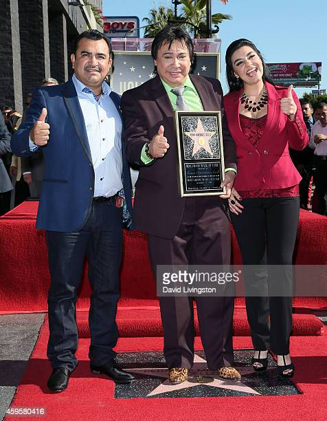 Musician Tony Melendez radio personality Renan Almendarez Coello aka El Cucuy de la Manana and singer Graciela Beltran attend Coello being honored...