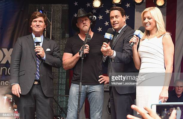 Musician Trace Adkins talks with cohosts Tucker Carlson Clayton Morris and Ainsley Earhard during FOX Friends All American Concert Series outside of...