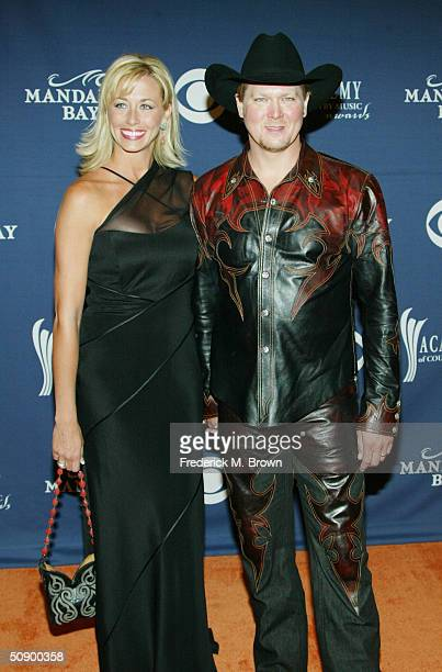Musician Tracy Lawrence and his Wife Becca Lawrence attend the 39th Annual Country Music Awards at the Mandalay Bay Hotel Casino on May 26 2004 in...