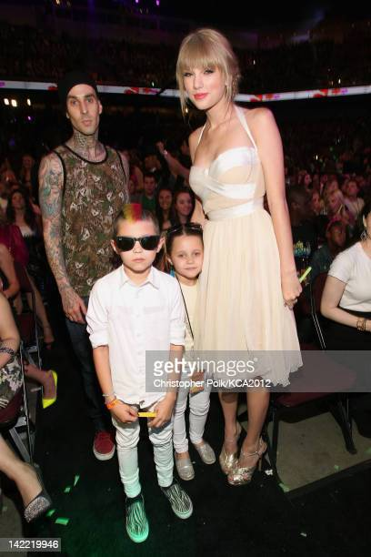 Musician Travis Barker and children with singer Taylor Swift at Nickelodeon's 25th Annual Kids' Choice Awards held at Galen Center on March 31 2012...
