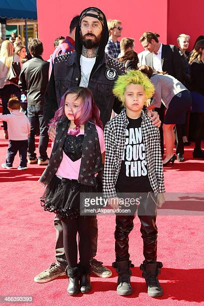 Musician Travis Barker and his children Alabama Luella Barker and Landon Asher Barker attend the premiere of 'The LEGO Movie' at Regency Village...
