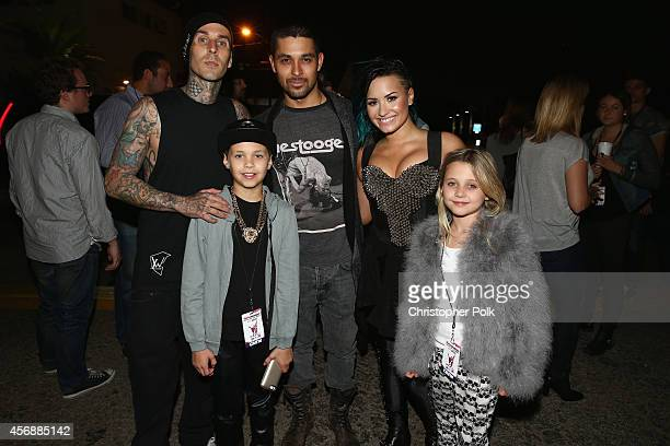 Musician Travis Barker Landon Barker actor Wilmer Valderrama recording artist Demi Lovato and Alabama Barker pose backstage during the Vevo CERTIFIED...