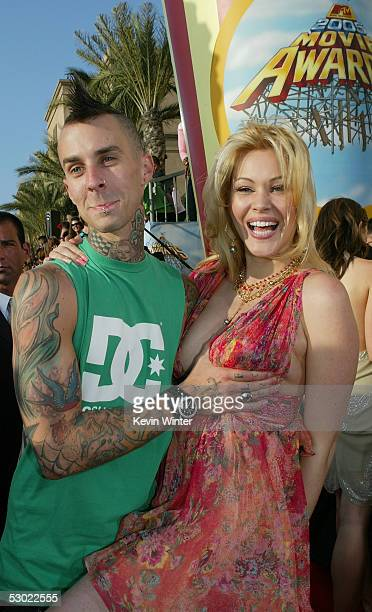 Musician Travis Barker of Blink 182 and his wife actress Shanna Moakler arrive to the 2005 MTV Movie Awards at the Shrine Auditorium June 4 2005 in...