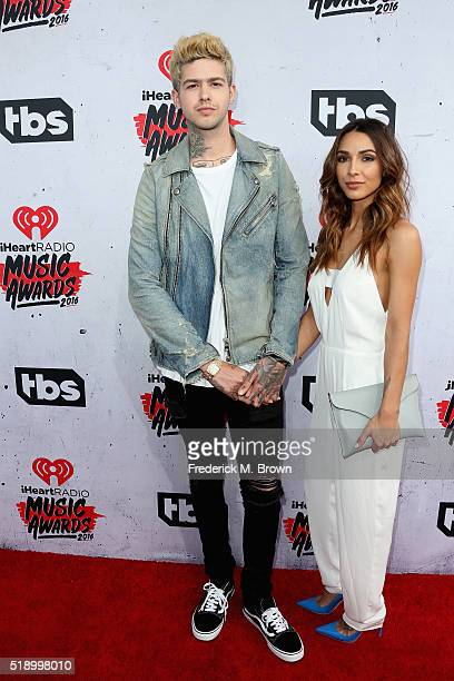 Musician Travis Mills and Michele Maturo attend the iHeartRadio Music Awards at The Forum on April 3 2016 in Inglewood California
