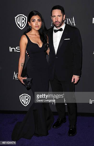 Musician Trent Reznor and Mariqueen Maandig attend the 2015 InStyle and Warner Bros 72nd Annual Golden Globe Awards PostParty at The Beverly Hilton...