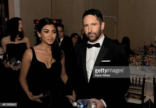 Musician Trent Reznor and Mariqueen Maandig attends the 72nd Annual Golden Globe Awards cocktail party at The Beverly Hilton Hotel on January 11 2015...