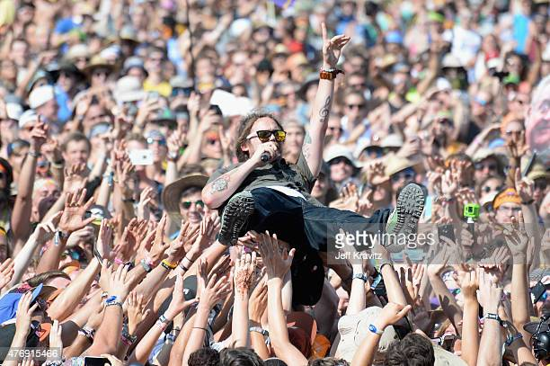 Musician Trevor Young of SOJA crowd surfs at What Stage during Day 2 of the 2015 Bonnaroo Music And Arts Festival on June 12 2015 in Manchester...